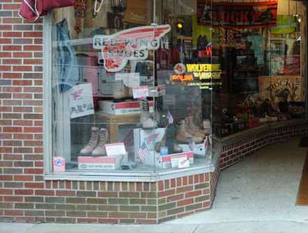 A photo of the left display window at Pauls Clothing and Shoe Store.